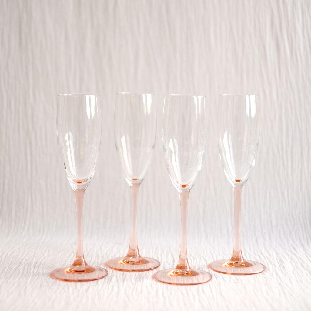 SET OF FOUR PINK STEM CHAMPAGNE GLASSES