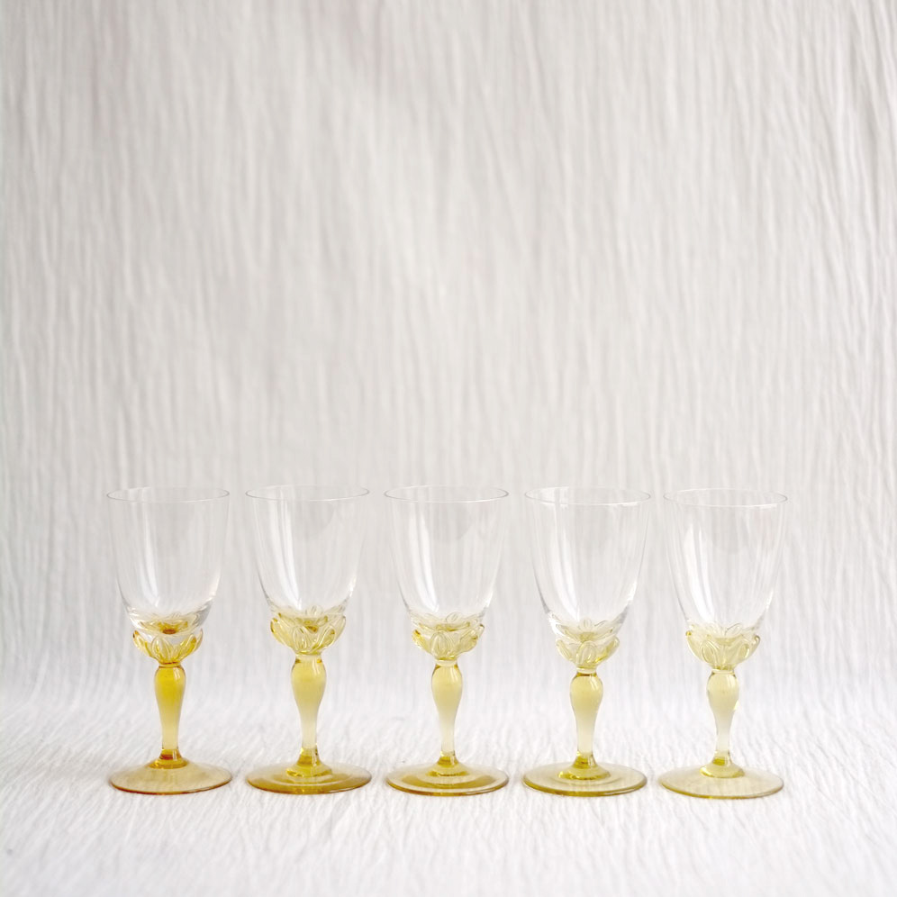 SET OF FIVE YELLOW STEM CHAMPAGNE GLASSES