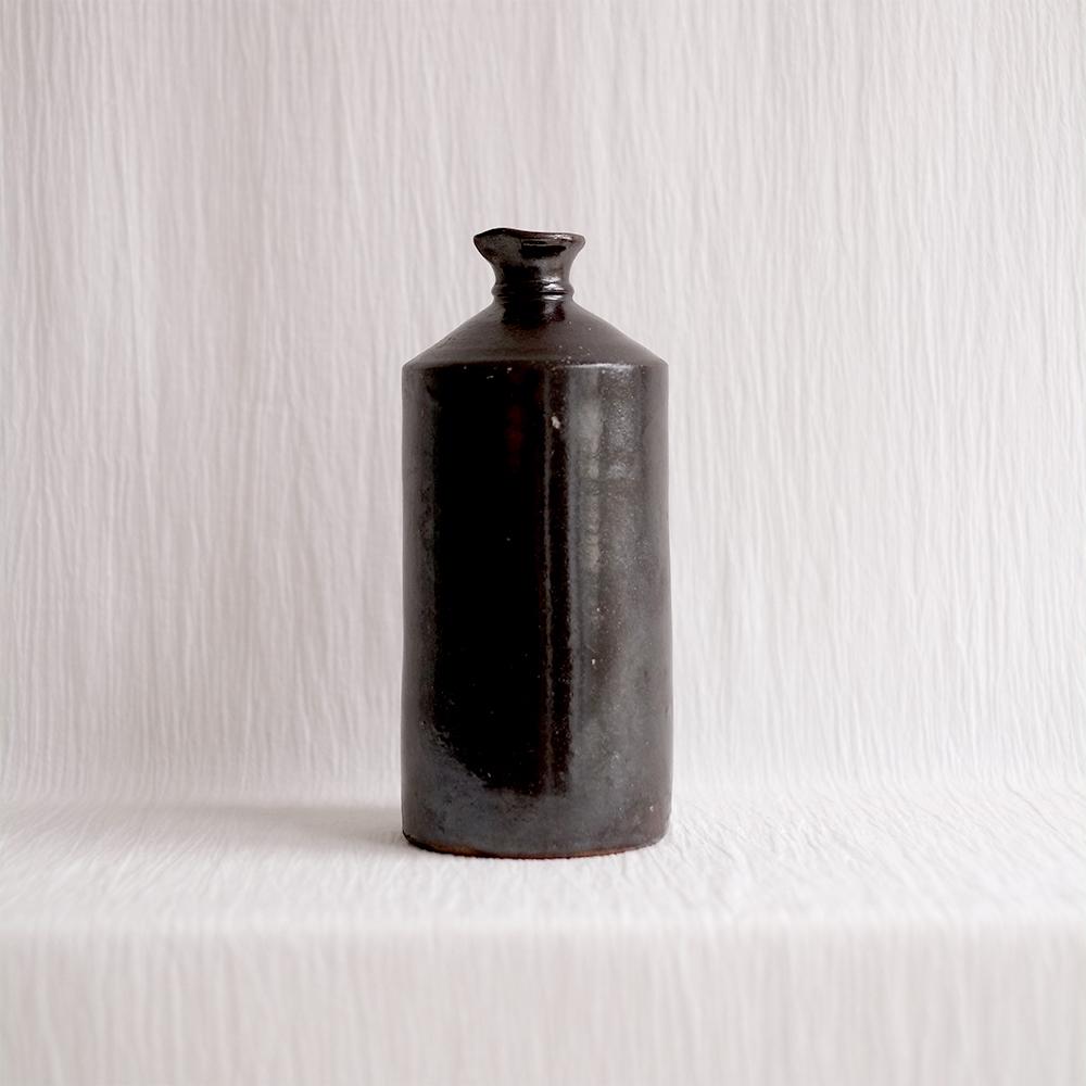 LARGE BLACK RUSTIC STONEWARE VESSEL
