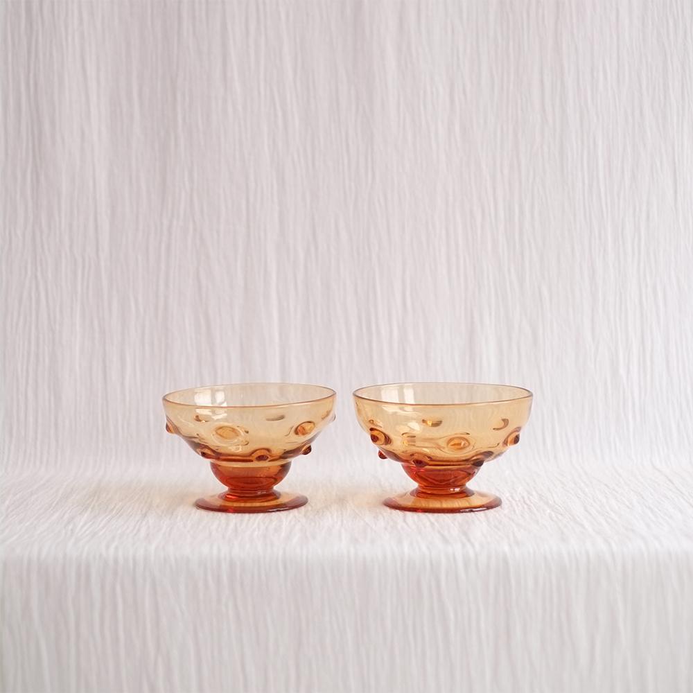 PAIR OF KNOBBLY ORANGE GLASS DESSERT DISHES