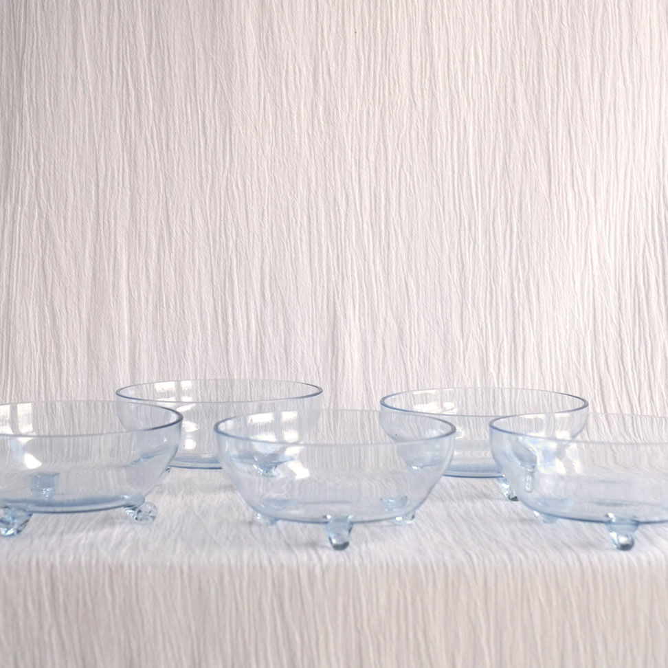 SET OF FIVE PALE BLUE GLASS FOOTED BOWLS