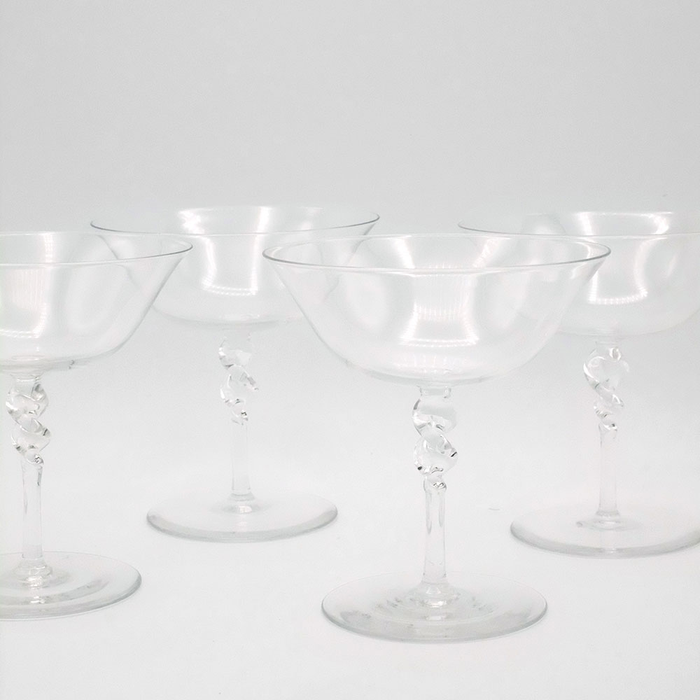 SET OF FOUR CHAMPAGNE COUPES WITH TWISTED STEM