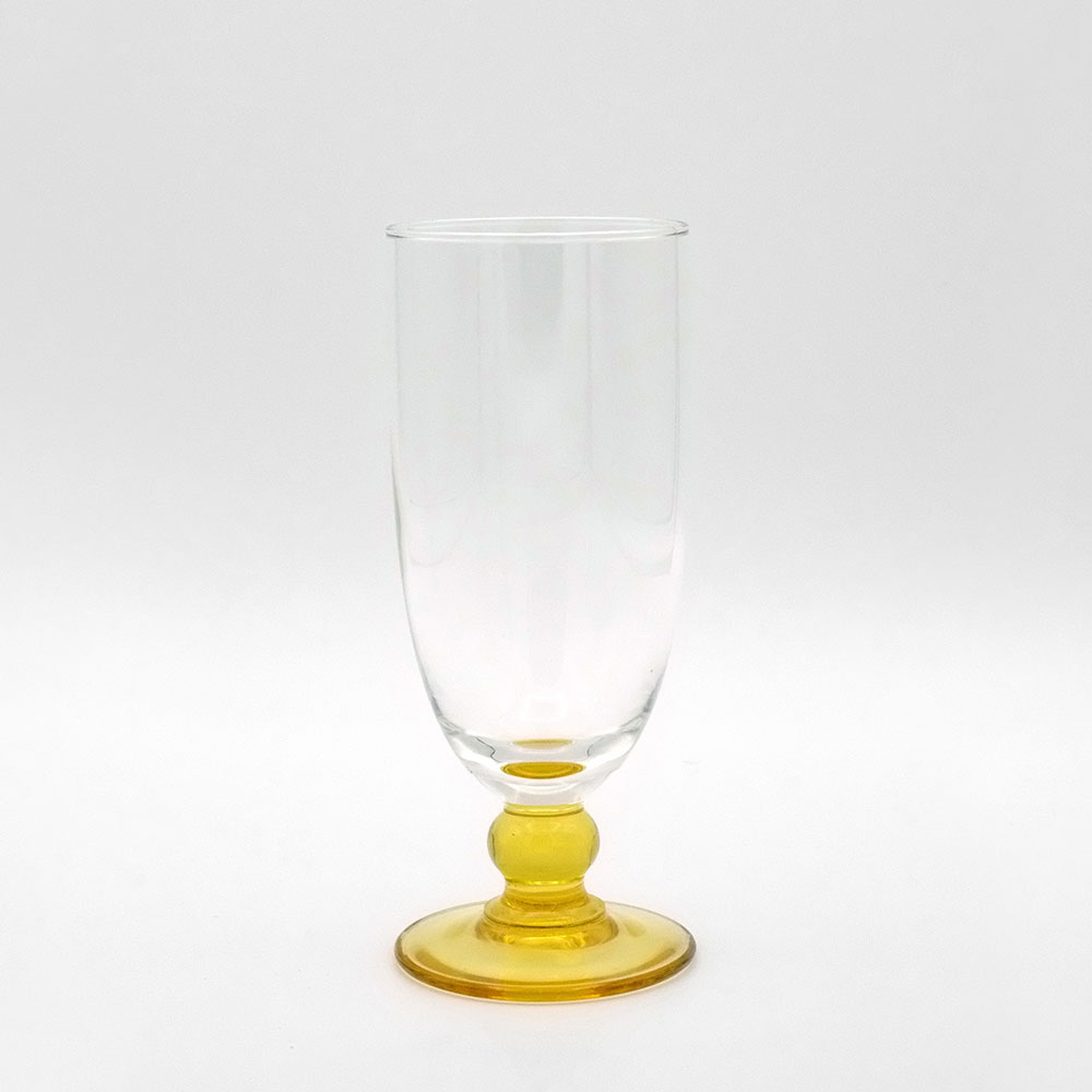 TWO CHAMPAGNE GLASSES WITH AMBER COLOURED GLASS BASE