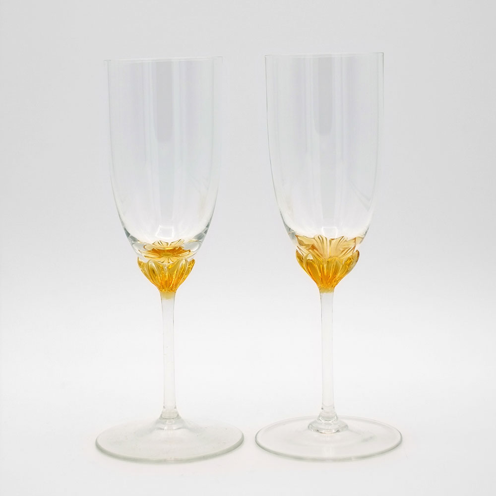 TWO DELICATE FLUTES WITH AMBER COLOURED GLASS BASE