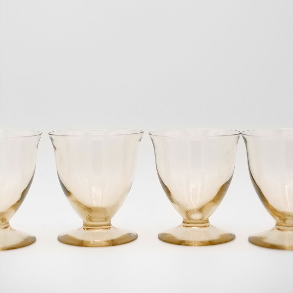 SET OF FOUR TAUPE COLOURED GLASS COUPES